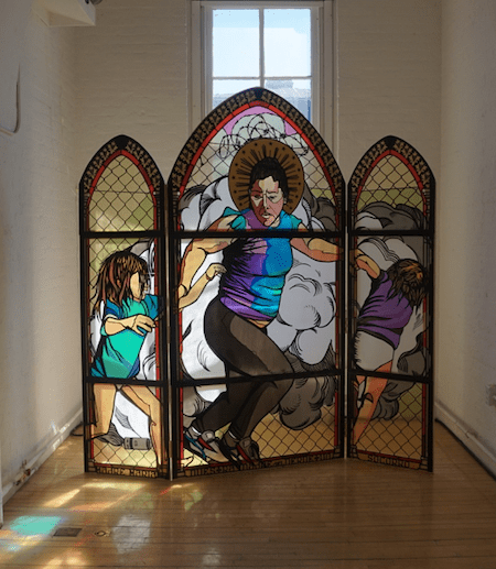 A stained glass representation of a mother and children running